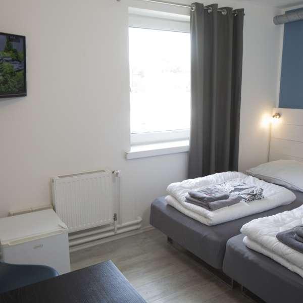 Endnu et billede af et dobbgeltværelse på Flensbed Hostel and Boardinghouse i Flensborg
