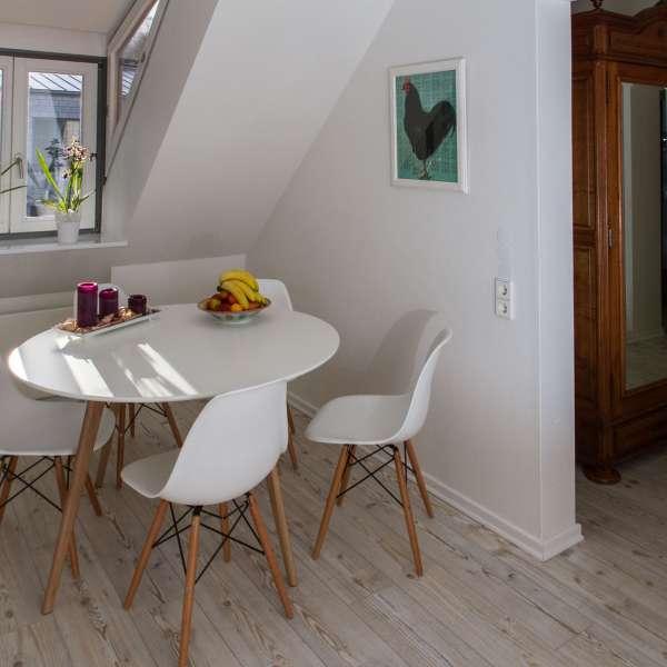 Indgangsarealet med siddemulighed på Gästehaus Lavendel-City i Flensborg
