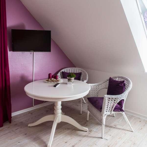 Siddehjørne på et af værelserne på Gästehaus Lavendel-City i Flensborg